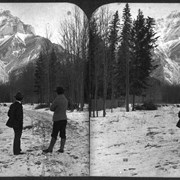 Cover image of [Byron Harmon and Elliott Barnes on Banff street (Muskrat St.?) with Cascade Mountain beyond]