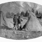 Cover image of [Stoney] Indian boys and playhouse teepees (5 feet high) [at Kootenay Plains, Alberta]