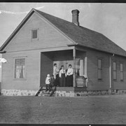 Cover image of Family on porch of house, [North Dakota?]