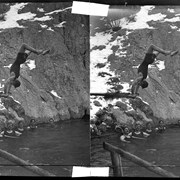 Cover image of Man doing handstand on diving board at Cave and Basin pool