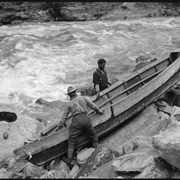 Cover image of Men portaging boat