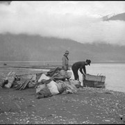 Cover image of Men unloading boat on Columbia River