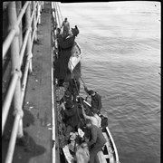 Cover image of People being lowered in lifeboat