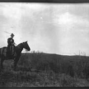 Cover image of Elliott Barnes Jr. on horseback at Jumping Pound