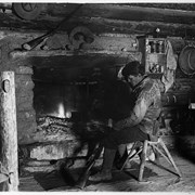 Cover image of Elliott Barnes in front of fireplace at his Kootenay Plains cabin