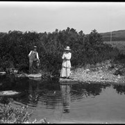 Cover image of Elliott Barnes and Lois fishing on Little Jumping Pound Creek