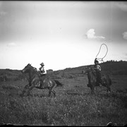 Cover image of Elliott and Robert Barnes roping horses at Jumping Pound