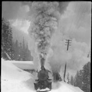 Cover image of 32. Glacier winter scene, train with snowplow