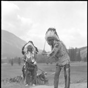 Cover image of Unknown man and John Hunter (Ihre Wapta)(Laughing Water-refers to the sound the North Wypress creek makes) golfing at Banff Springs Hotel golf course