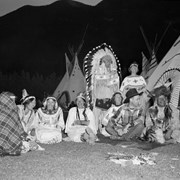 Cover image of 3 unidentified women, Eliza Hunter, Katherine?, Ernie Kehr, George McLean (Walking Buffalo)(Tatanga Mani), Stoney Nakoda. Standing - Philip and Jean Godsell