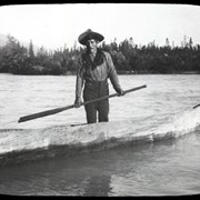 Cover image of At the Fraser in 1908 [Unidentified man in dugout canoe]