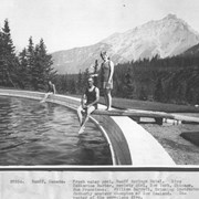 Cover image of Banff, Canada. Freshwater pool, Banff Springs Hotel. Miss Catherine Barber, society girl, New York, Chicago, San Francisco. William Barrett, swimming instructor formerly amateur champion of New Zealand. Inventor of the aeroplane dive  / 27034