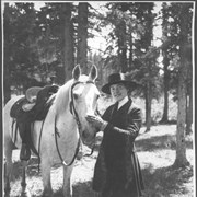 "Cover image of Banff, Canada. Miss Catherine Barber, society girl of Chicago, New York and San Francisco, and her horse, ""Peter Pan"", leaving Banff Springs Hotel for a ride in the mountains / 27035"