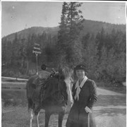 Cover image of Banff, Canada. Mrs. W. A. Williamson, Chicago and Winnipeg, standing near horse / 27105