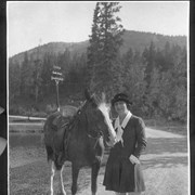 Cover image of Banff, Canada. Mrs. W. A. Williamson, Chicago and Winnipeg, standing near horse / 27106