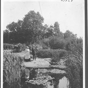 Cover image of Sir George Barnard, Lieutenant Governor, B. C., and his wife at the Lily Pond in the grounds of the Government House / 27828