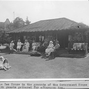 Cover image of The Tea House in the grounds of the Government House with guests gathered for afternoon tea / 28010