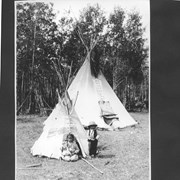 Cover image of Play teepee for Indian children. Children of Enos Hunter Morley, Alberta. Julia, girl age five, Laurier, boy age three / 27569