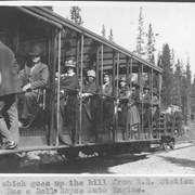 Cover image of Trolley which goes up the hill from R. R. station to Hotel Lake Louise. Has a Rolls Royce auto engine / 27603
