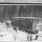Cover image of Trolley which goes up the hill from R. R. station to Hotel Lake Louise. Has a Rolls Royce auto engine / 27605