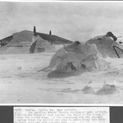 Cover image of Canada. Hudson Bay. Cape Dufferin. The Revillon Freres trading station at Cape Dufferin. Notice the banks of snow against the walls of the house to keep the drifts away. In the foreground are two Esquimo igloos which the natives who came to trade furs built as their stay, may last several days / 38881