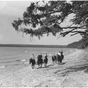 Cover image of Canada. Manitoba Riding Mt. National Park. Children riding ponies along the shore of Clear Lake / CN209