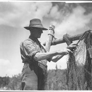 Cover image of Canada (Nova Scotia). Close-up of an old fisherman on Nova Scotia's South Shore shown mending a net / CN269