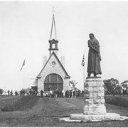 Cover image of Canada. Nova Scotia. Grand Pre. Evangeline's statue and the church in which are now exhibited various objects used by the people of that section during her time / CN204