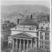 Cover image of Canada. Quebec Province. Montreal. Canada's financial heart. The head office of the Bank of Montreal, founded in 1817, and one of the British Empire's strongest institutions. The uptown district and Mount Royal are seen in the background / CN63