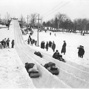 Cover image of Canada. Montreal, Quebec. On the northerly slopes of Mt. Royal is the Park Slide, a private toboggan club comprising four chutes. Photo shows toboggan enthusiasts coming down the chutes of the slides / CN41