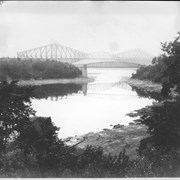 Cover image of Canada. The pigmy and the giant. In the foreground is the steel bridge over the Chaudiere River as it flows into the St. Lawrence. In the background is the famous Quebec Bridge, one of the wonders of the engineering world, used by the Canadian National Railways / CN116