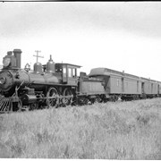Cover image of Pacific Express waiting for Atlantic Express at Medicine Hat (No.9). 7/l/94