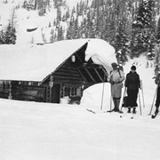 Cover image of Pat, Dell, and Jim Brewster at Sunshine cabin on skis