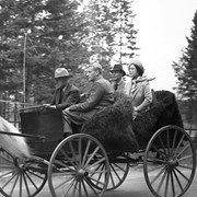 Cover image of Jim Brewster driving King George VI and Queen Elizabeth and Colonel Panet (chief of Canadian Pacific Railway police) in Democrat, 1939