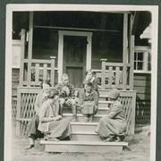 "Cover image of ""A group on the front porch at camp"""