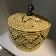 Cover image of Lidded Basket with Stone Woman's Head Handle